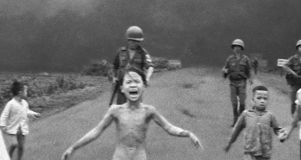 The Napalm Girl running down a road